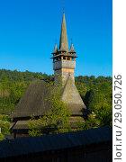 Купить «Image of wooden Biserica Sf. Nicolae in Maramures», фото № 29050726, снято 14 сентября 2017 г. (c) Яков Филимонов / Фотобанк Лори