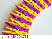 Купить «Row from yellow and pink linen clothespins», фото № 29050794, снято 30 июля 2018 г. (c) Володина Ольга / Фотобанк Лори