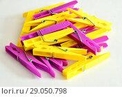 Купить «Hill from yellow and pink linen clothespins», фото № 29050798, снято 30 июля 2018 г. (c) Володина Ольга / Фотобанк Лори