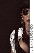 Купить «Steampunk girl portrait on black. Monocular lens», фото № 29053650, снято 13 апреля 2017 г. (c) katalinks / Фотобанк Лори