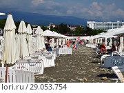 Sochi, Russia - June 5. 2018. people on beach equipped with umbrellas and sun loungers. Редакционное фото, фотограф Володина Ольга / Фотобанк Лори