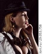 Купить «Sexy girl wearing steampunk costume on black», фото № 29053758, снято 13 апреля 2017 г. (c) katalinks / Фотобанк Лори