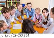 Купить «Diligent schoolkids sitting in classroom attentively listening t», фото № 29053854, снято 28 января 2018 г. (c) Яков Филимонов / Фотобанк Лори