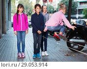 Купить «Joyful children play on street of summer city», фото № 29053914, снято 21 октября 2017 г. (c) Яков Филимонов / Фотобанк Лори