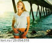 Купить «Elegant woman is resting on the rocks in her free time», фото № 29054018, снято 17 июля 2017 г. (c) Яков Филимонов / Фотобанк Лори
