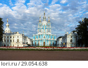 Купить «St. Petersburg in the summer. Smolny Cathedral against the blue sky with clouds, on Rastrelli Square flower bed», фото № 29054638, снято 2 сентября 2018 г. (c) Виктория Катьянова / Фотобанк Лори