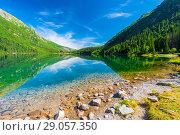 Купить «Beautiful Lake Morskie Oko in the morning on a sunny day attractions in Poland», фото № 29057350, снято 18 августа 2017 г. (c) Константин Лабунский / Фотобанк Лори