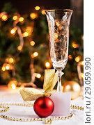 Купить «festive table decorated with Christmas balls and beads», фото № 29059990, снято 10 ноября 2016 г. (c) Tetiana Chugunova / Фотобанк Лори
