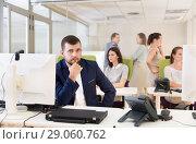 Купить «Pensive businessman in coworking space», фото № 29060762, снято 1 августа 2018 г. (c) Яков Филимонов / Фотобанк Лори