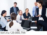 Купить «Team discussing business project during coffee break», фото № 29060794, снято 28 октября 2016 г. (c) Яков Филимонов / Фотобанк Лори