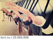 Купить «Girls practicing wall yoga with straps in studio», фото № 29060898, снято 29 января 2018 г. (c) Яков Филимонов / Фотобанк Лори
