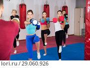 Купить «women are boxing and doing kick with coach», фото № 29060926, снято 8 октября 2017 г. (c) Яков Филимонов / Фотобанк Лори