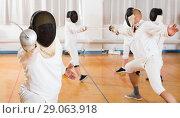 Купить «Portrait of fencer practicing lunge with foil», фото № 29063918, снято 30 мая 2018 г. (c) Яков Филимонов / Фотобанк Лори
