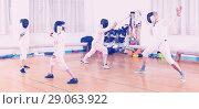 Купить «Young fencers training with coach», фото № 29063922, снято 30 мая 2018 г. (c) Яков Филимонов / Фотобанк Лори