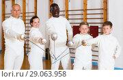 Купить «Portrait of cheerful mixed age group of athletes», фото № 29063958, снято 30 мая 2018 г. (c) Яков Филимонов / Фотобанк Лори