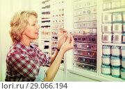 Купить «mature woman in sewing store», фото № 29066194, снято 22 мая 2019 г. (c) Яков Филимонов / Фотобанк Лори