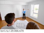 Купить «realtor showing new home to couple with blueprint», фото № 29066670, снято 4 июня 2017 г. (c) Syda Productions / Фотобанк Лори