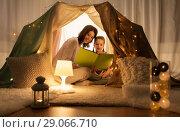 Купить «happy family reading book in kids tent at home», фото № 29066710, снято 27 января 2018 г. (c) Syda Productions / Фотобанк Лори