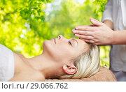 Купить «close up of woman having face massage in spa», фото № 29066762, снято 18 декабря 2014 г. (c) Syda Productions / Фотобанк Лори