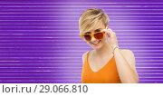 Купить «woman in sunglasses over ultra violet background», фото № 29066810, снято 30 июня 2018 г. (c) Syda Productions / Фотобанк Лори