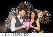 Купить «happy couple with gift box at birthday party», фото № 29066830, снято 15 декабря 2017 г. (c) Syda Productions / Фотобанк Лори