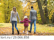 Купить «happy family walking at autumn park», фото № 29066858, снято 19 октября 2017 г. (c) Syda Productions / Фотобанк Лори