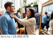 Купить «couple choosing clothes at vintage clothing store», фото № 29066878, снято 30 ноября 2017 г. (c) Syda Productions / Фотобанк Лори