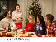 Купить «happy friends having christmas dinner at home», фото № 29066886, снято 17 декабря 2017 г. (c) Syda Productions / Фотобанк Лори
