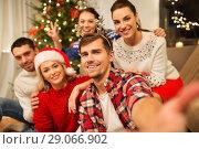 Купить «friends celebrating christmas and taking selfie», фото № 29066902, снято 17 декабря 2017 г. (c) Syda Productions / Фотобанк Лори