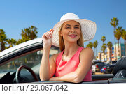 Купить «happy woman in convertible car over venice beach», фото № 29067042, снято 17 августа 2017 г. (c) Syda Productions / Фотобанк Лори