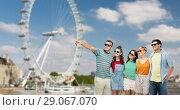 Купить «friends in sunglasses over ferry wheel in london», фото № 29067070, снято 30 июня 2018 г. (c) Syda Productions / Фотобанк Лори