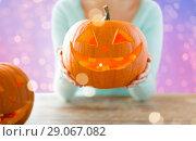 Купить «close up of woman with halloween pumpkin», фото № 29067082, снято 17 сентября 2014 г. (c) Syda Productions / Фотобанк Лори