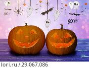 Купить «close up of halloween pumpkins on table», фото № 29067086, снято 17 сентября 2014 г. (c) Syda Productions / Фотобанк Лори