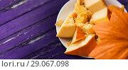 Купить «pumpkin cut into pieces on a plate», фото № 29067098, снято 15 сентября 2017 г. (c) Syda Productions / Фотобанк Лори