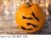 Купить «pumpkins with bats or halloween party decorations», фото № 29067102, снято 18 сентября 2017 г. (c) Syda Productions / Фотобанк Лори