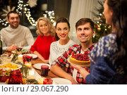 Купить «happy friends having christmas dinner at home», фото № 29067290, снято 17 декабря 2017 г. (c) Syda Productions / Фотобанк Лори