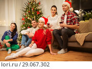 Купить «friends celebrating christmas and drinking wine», фото № 29067302, снято 17 декабря 2017 г. (c) Syda Productions / Фотобанк Лори