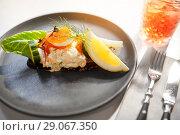 Купить «close up of toast skagen with caviar and bread», фото № 29067350, снято 16 января 2017 г. (c) Syda Productions / Фотобанк Лори
