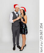 Купить «couple with champagne glasses at christmas party», фото № 29067354, снято 15 декабря 2017 г. (c) Syda Productions / Фотобанк Лори