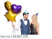 Купить «happy couple with party caps and balloons», фото № 29067370, снято 3 марта 2018 г. (c) Syda Productions / Фотобанк Лори