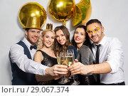 Купить «happy friends clinking champagne glasses at party», фото № 29067374, снято 3 марта 2018 г. (c) Syda Productions / Фотобанк Лори