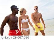 Купить «happy friends walking along summer beach», фото № 29067386, снято 29 июля 2018 г. (c) Syda Productions / Фотобанк Лори