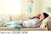 Купить «happy pregnant woman calling on smartphone at home», фото № 29067434, снято 9 сентября 2017 г. (c) Syda Productions / Фотобанк Лори