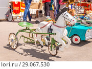 """Купить «""""Horse pedal"""". An old children's bicycle. Reconstruction of the Soviet time during the press day in the Strukovsky Park.», фото № 29067530, снято 27 мая 2018 г. (c) Акиньшин Владимир / Фотобанк Лори"""
