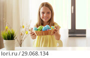 happy girl showing colored easter egg at home. Стоковое видео, видеограф Syda Productions / Фотобанк Лори