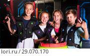 Купить «Happy teenagers with laser guns», фото № 29070170, снято 15 октября 2019 г. (c) Яков Филимонов / Фотобанк Лори