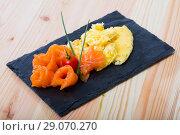 Купить «Traditional dish of Norwegian cuisine of omelet with salmon at plate», фото № 29070270, снято 20 сентября 2018 г. (c) Яков Филимонов / Фотобанк Лори