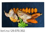 Купить «Top view of quail teriyaki with grilled carrots and broccoli», фото № 29070302, снято 25 сентября 2018 г. (c) Яков Филимонов / Фотобанк Лори
