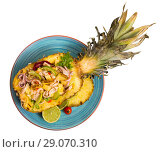 Купить «Top view of salad with calamari, pineapple on blue tablecloth», фото № 29070310, снято 24 сентября 2018 г. (c) Яков Филимонов / Фотобанк Лори