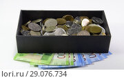 Купить «Coins are thrown in a box. Piggy bank of Russian money. Russian rubles.», видеоролик № 29076734, снято 23 июля 2019 г. (c) Леонид Еремейчук / Фотобанк Лори